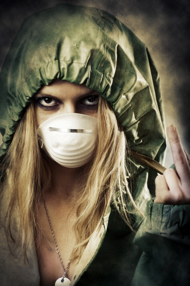 Portrait of post apocalypse girl which shows a gesture to the shot. Woman in protective suit and mask